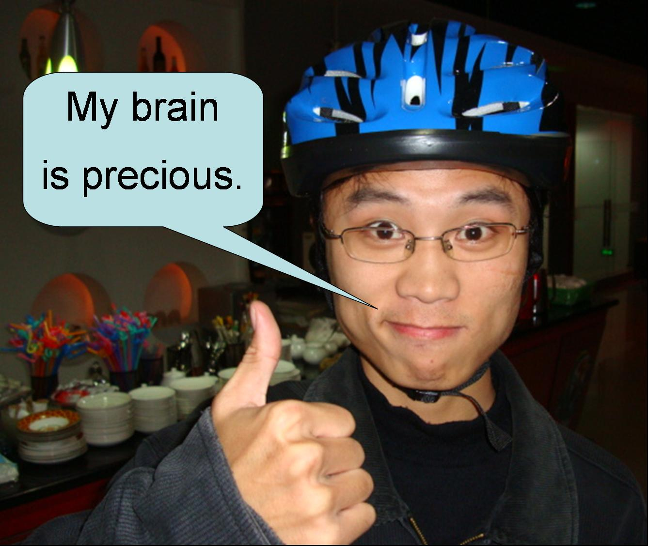 "Picture:  Poster boy for helmet use in China.  ""My brain is precious."""